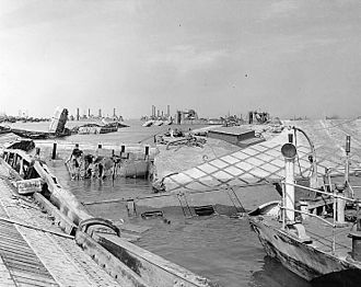 "Mulberry harbour - Wrecked pontoon causeway of one of the ""Mulberry"" artificial harbours, following the storm of 19–22 June 1944."
