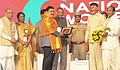 N. Chandrababu Naidu felicitating the Minister of State for Science & Technology and Earth Sciences, Shri Y.S. Chowdary, at the National Women Parliament, in Amaravathi, Andhra Pradesh.jpg
