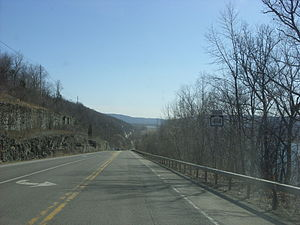 New York State Route 414 - NY 414 southbound in Hector just past the NY 79 junction. This section of the route overlooks Seneca Lake (at right) as it heads downhill.