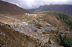 The famous outpost of Naamche Bazaar in the Khumbu region close to Mount Everest. The town is built on terraces in what resembles a giant Greek theatre.