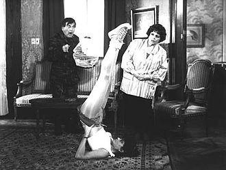 "Nelly Beltrán - Left to right: Mario Sánchez, Adriana Salgueiro (doing shoulder stand) and Nelly Beltrán, in ""Los colimbas al ataque"" (1987)"