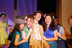 Brown Opera Productions - Nemorino surrounded by the village girls as Adina looks on. From BOP's Spring 2009 show L'elisir d'amore