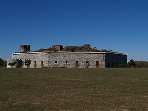 Clarks Point Light - The lantern of the lighthouse is barely visible over the right center of the fort.