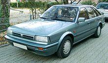 [Obrazek: 220px-Nissan_Bluebird_front_20071112.jpg]