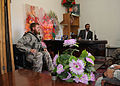 Nooruddin Rahmani, right, the intelligence chief in Ghazni, Afghanistan, speaks to U.S. Navy Petty Officer 1st Class Derrick Vanlaere, a Ghazni Provincial Reconstruction Team member, and other coalition forces 100821-F-CG264-040.jpg