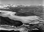 Norris and Taku Glaciers, terminus of valley glacier, trimline, and braided streams, August 24, 1969 (GLACIERS 6064).jpg