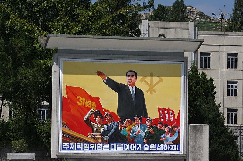 https://upload.wikimedia.org/wikipedia/commons/thumb/e/ef/North_Korea_-_Propaganda_poster_%285015259183%29.jpg/800px-North_Korea_-_Propaganda_poster_%285015259183%29.jpg