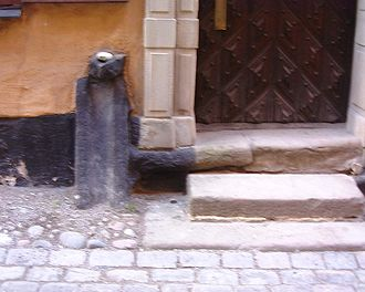 Sewage - A medieval waste pipe in Stockholm Old Town formerly deposited sewage on the street to be flushed away by rain.