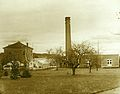 Old Horticulture Building with greenhouses and smokestack, circa 1907 (7160055049).jpg