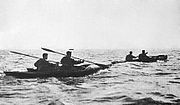 twotwoman canoes at sea