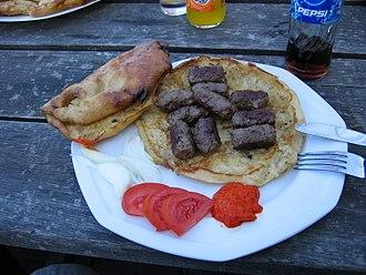 Ćevapi - Ćevapi served with ajvar and traditional Bosnian flatbread called lepinja