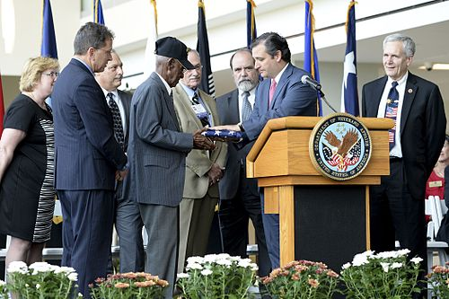 Cruz presents a U.S. flag to World War II veteran Richard Arvine Overton during opening ceremony for outpatient clinic in Austin on August 22, 2013 Overton.jpg