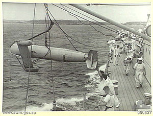 Paravane (weapon) - A paravane being lowered into the sea from an Australian warship in 1940.