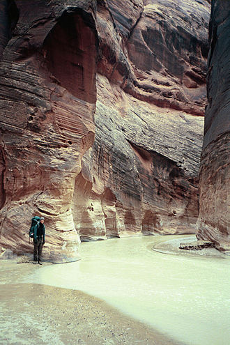 Paria River - A backpacker at the confluence of Buckskin Gulch and the Paria River