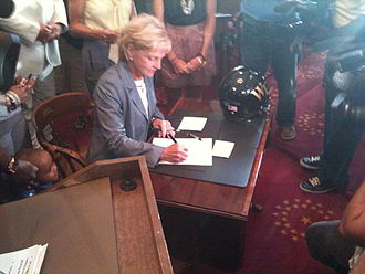 Dale Folwell - The Gfeller and Waller families watch Gov. Perdue sign the Gfeller-Waller Concussion Awareness Act.