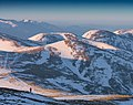 Photographer stays on a hill in a mountains of Carpathians.jpg
