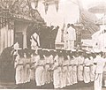 Phra Long of Ananda Mahidol on the Royal Chariot with three poles carried by Royal Thai Navy sailors.jpg