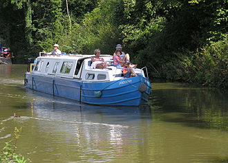 Pleasure craft - A pleasure boat on the Kennet and Avon Canal near the Dundas Aqueduct, Wiltshire, England.
