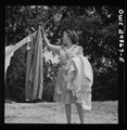 Point Pleasant, West Virginia. Mrs. Fergusen taking the clothes off the line LCCN2017855346.tif