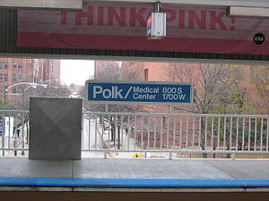 "Polk station - An older sign at the station with the name ""Polk/Medical Center."""