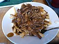 Poutine with pulled pork makes everything better (8515637447).jpg
