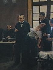 """Professor Charcot (left) of Paris' Salpêtrière demonstrates hypnosis on a """"hysterical"""" patient, """"Blanche"""" (Marie) Wittman, who is supported by Dr. Joseph Babiński."""