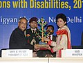 Pranab Mukherjee being presented a memento by the Union Minister for Social Justice & Empowerment, Kumari Selja, at the presentation ceremony of the National Awards for the Empowerment of Persons with Disabilities 2013.jpg