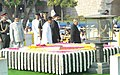 Pranab Mukherjee performing parikrama at the Samadhi of Mahatma Gandhi on his 143rd birth anniversary, at Rajghat, in Delhi on October 02, 2012. The Union Minister for Urban Development, Shri Kamal Nath is also seen.jpg