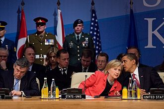 Hillary Clinton's tenure as Secretary of State - Obama and Clinton speaking with one another at the 21st NATO summit in April 2009