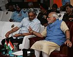 Prime Minister Narendra Modi having discussions with Defence Minister Manohar Parrikar during the Combined Commanders' Conference 2015.JPG