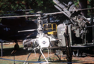 Gyrodyne QH-50 DASH - A remote control QH-50 drone helicopter on display beside an M118 90 mm anti-aircraft gun at the Fort Polk Military Museum outdoor park