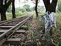 Rails and Scarecrow-Like Sculpture - Burma-Siam 'Death Railway' - Thanbyuzayat - Near Mawlamyine (Moulmein) - Myanmar (Burma) (11954717473).jpg