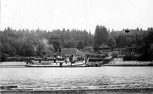 Port Madison-Suquamish-Poulsbo route - Steamer Reliance at Port Madison circa 1914.
