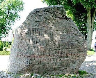 Jelling Municipality - Runeside of Harald Bluetooth's great Jelling stone at the church in Jelling, Denmark.