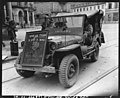 SC 196671 - Members of the 1st French Army, in the Mulhouse area, France, decorated this jeep with a captured picture of Hitler. To further show their sentiment for Adolf, they completed the picture by placing a chain around his neck.jpg
