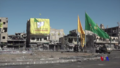SDF, YPG, and YPJ flags in Raqqa centre.png