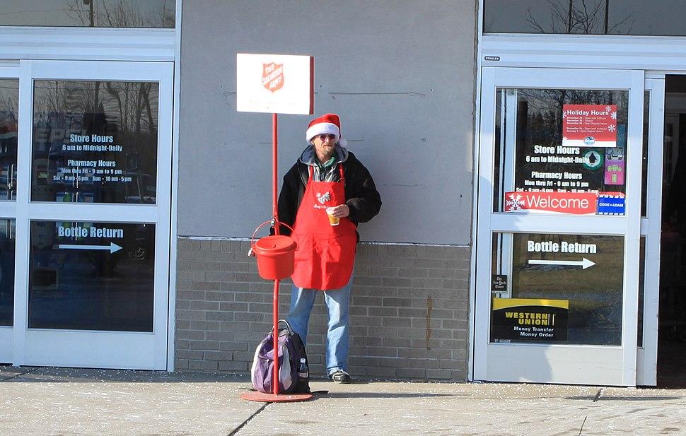 Salvation Army red kettle at supermarket entrance Ypsilanti Michigan