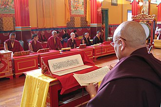 Kagyu Samye Ling Monastery and Tibetan Centre - Samye Ling Temple with Sangha and Abbot Lama Yeshe Losal Rinpoche leading prayers.