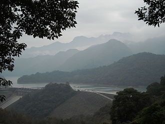 Shihmen Dam - View from a nearby mountain, showing the main dam (center) and spillway (lower left).