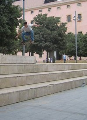 Barcelona Museum of Contemporary Art - Skateboarder ollies over a set of stairs at MACBA