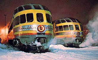 Chicago, Milwaukee, St. Paul and Pacific Railroad - Two Skytop Lounges in their second Milwaukee Road paint scheme, matching Union Pacific colors. These cars were part of the Twin Cities Hiawatha equipment pool