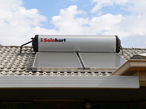 Feed-in tariffs in Australia - A solar hot water panel and integrated tank on a house roof, 2006