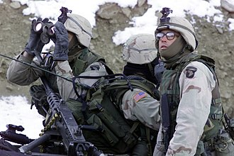 Operation Anaconda - U.S. soldiers from the 1st Battalion, 187th Infantry Regiment, 101st Airborne Division (Air Assault), scan the ridgeline for enemy forces during Operation Anaconda, March 4, 2002.