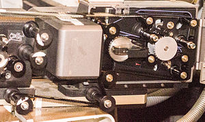 Sony Dynamic Digital Sound - A Sony DFP-R2000 SDDS reader mounted on a Norelco AAII projector, with film threaded.