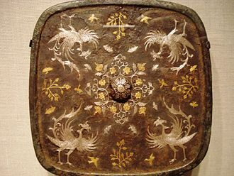 A square bronze mirror with a phoenix motif of gold and silver inlaid with lacquer, 8th-century Square mirror with phoenix motif, Tang Dynasty.jpg