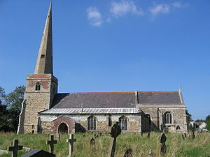 A stone church seen from the south with, from the left, a tower with a tall spire, the nave with a protruding aisle and a porch, and a shorter chancel