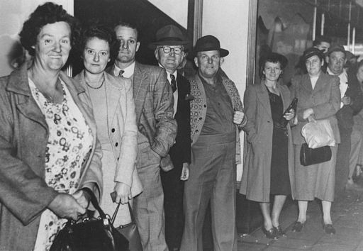 StateLibQld 1 296531 People queuing in a line, ca. 1954