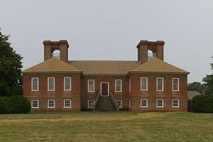 Plantation complexes in the Southern United States - The austere Georgian-style main house at Stratford Hall, built on an H-plan that was more typical of the earlier Elizabethan and Jacobean architecture of England.  It was completed in 1738 near Lerty, Virginia.