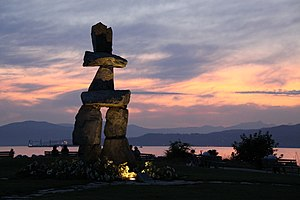 Sunset on the inuksuk at English Bay