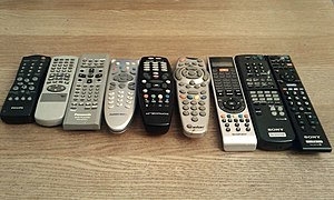 9 remote controls labeled as follows, from lef...